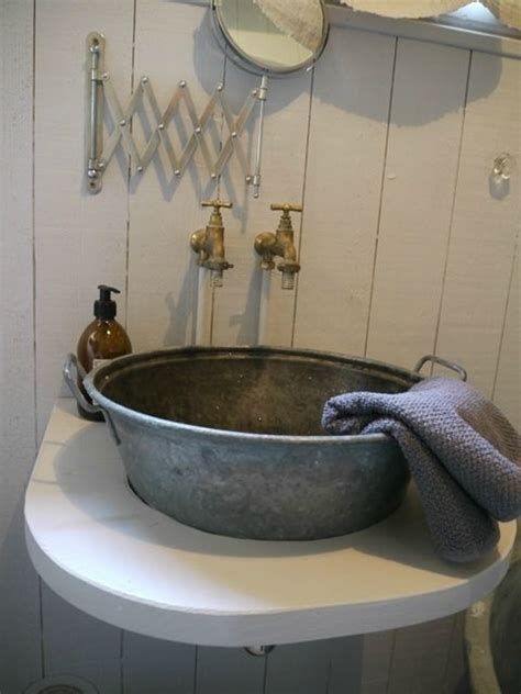 Great galvanized vessel sink! Nice rustic bathroom touch