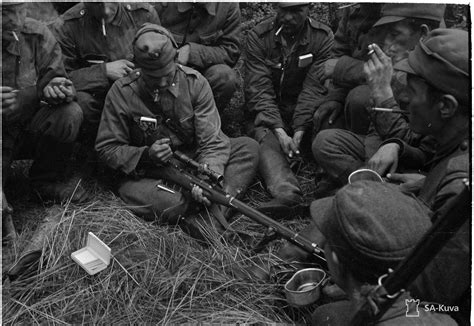 Finnish soldiers check out a captured Soviet sniper rifle